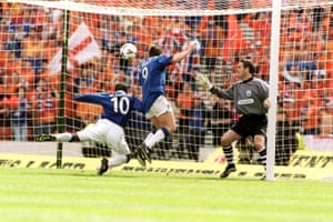 Rangers' Rod Wallace (left) gets the last touch as he and teammate Billy Dodds (centre) secure the fourth goal past Aberdeen's stand-in goalkeeper Robbie Winters in Rangers' 4-1 win in the 2000 Scottish Cup Final.