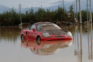 A car partially submerged after Typhoon Hagibis