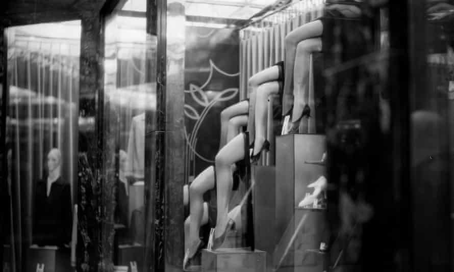 A display of sheer nylons in a shop window circa 1925.