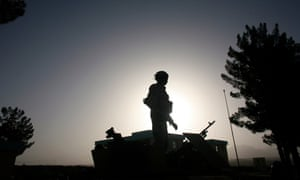A US soldier stands on top of a vehicle near the town of Qalat