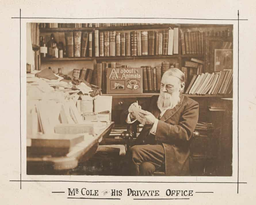 An archival photo of a man with a beard in a room full of books