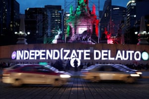 Mexico City, Mexico: Greenpeace activists place illuminated words that read: 'Free yourself from cars' during a demonstration at the Angel of the Independence monument