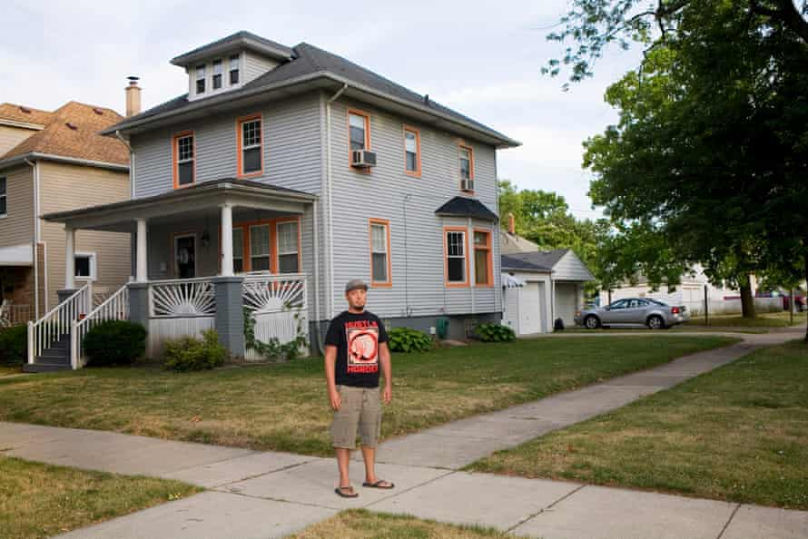 Brian Dodson in front of his home in in Wyandotte, MI.