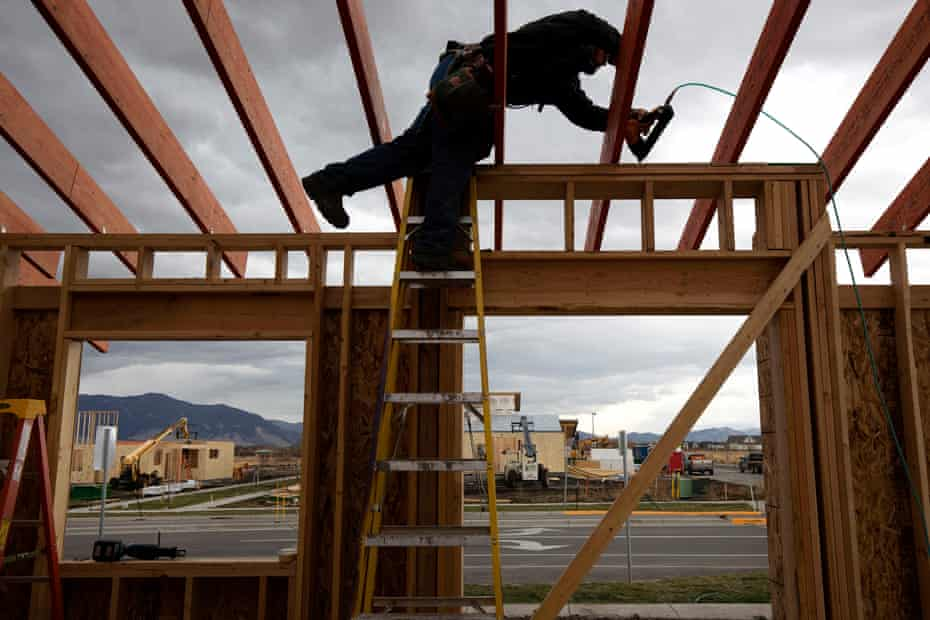 Construction worker Dan Reed works on a new house in the Lakes at Valley West, a new residential construction area in Bozeman.