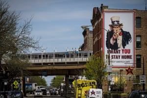 """A L train passes an """"I Want You To Stay Home"""" billboard in Chicago, Illinois, U.S., on Thursday, May 7, 2020. Governor Pritzker extended the state's stay-at-home order through the end of May, but he loosened restrictions on certain outdoor activities starting May 1."""