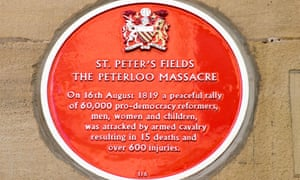 Red plaque commemorating the Peterloo massacre in Manchester.