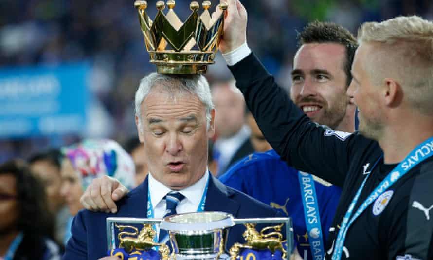 Leicester City manager Claudio Ranieri lifts the Premier League trophy.