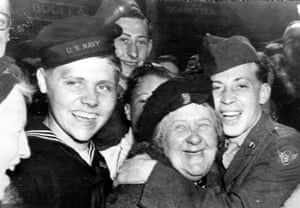 US soldiers hug an English woman as they celebrate the surrender of Germany, May 7, 1945, in London's Piccadilly Circus
