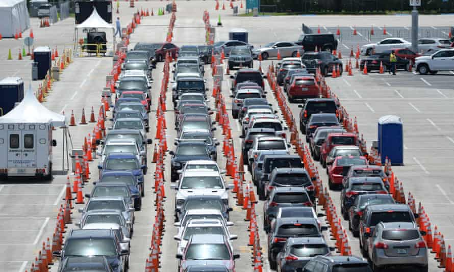Cars wait at a testing site in Florida.