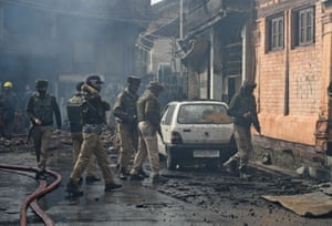 Srinagar, India. Troops inspect the site where a gun battle took place between suspected militants and Indian government forces, both sides suffered fatalities