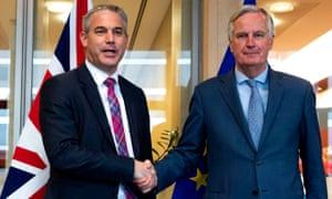 Britain's Brexit secretary, left, with the EU's chief Brexit negotiator Michel Barnier.