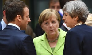 French President Emmanuel Macron (left), German Chancellor Angela Merkel (centre) and Theresa May at an EU summit last year.