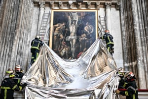 Bordeaux, FranceFirefighters protect a painting with a flameproof blanket during a drill aimed at preserving artworks displayed in St. Andrew's Cathedral.