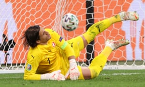 Yann Sommer of Switzerland fails to save the winning Spain penalty scored by Mikel Oyarzabal.