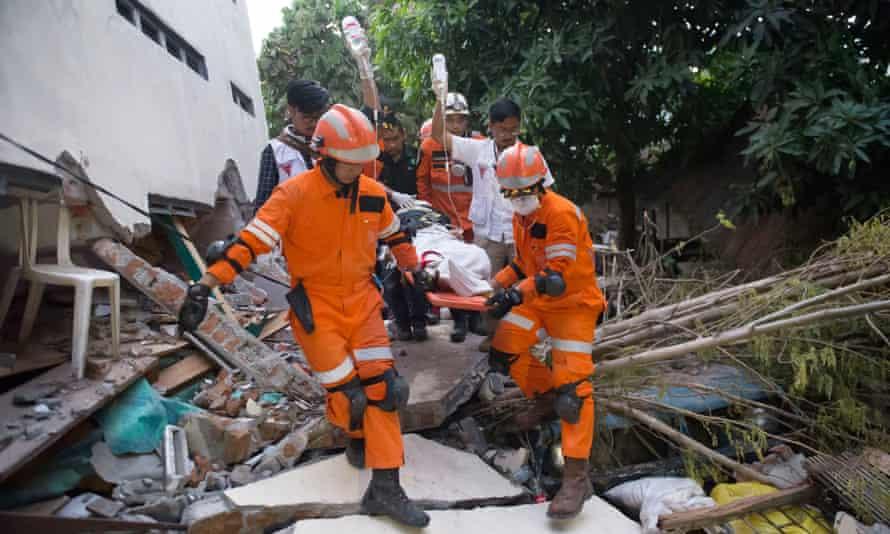 Rescue personnel evacuate an earthquake survivor in Palu.