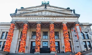 Assistants of Chinese artist Ai Wei Wei decorate the columns of Berlin's Konzerthaus with lifejackets.