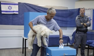 A man votes at a polling station in Rosh Haayin, Israel, on 17 September.
