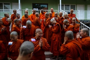 Novice monks gather at the Songdhammakalyani monastery in Nakhon Pathom province
