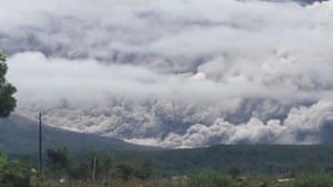 A view of smoke and ash plumes as the Mount Semeru volcano erupts on 16 January 2021