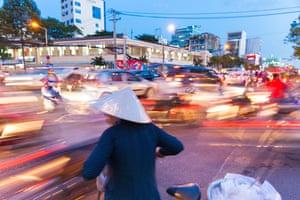woman bicycle Vietnam traffic