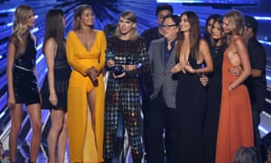 """Taylor Swift, centre, accepts the award for video of the year for """"Bad Blood"""" at the MTV Video Music Awards"""
