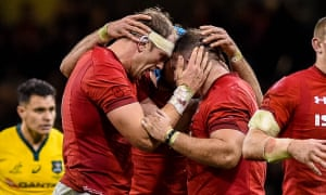 Alun Wyn Jones, Justin Tipuric and Dillon Lewis of Wales celebrate after the final whistle.