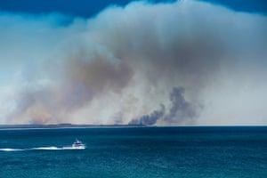 Bushfires are seen looking north from Forster, NSW