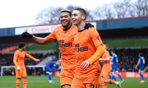 Miguel Almiron of Newcastle United celebrates with teammate Joelinton after opening the scoring.