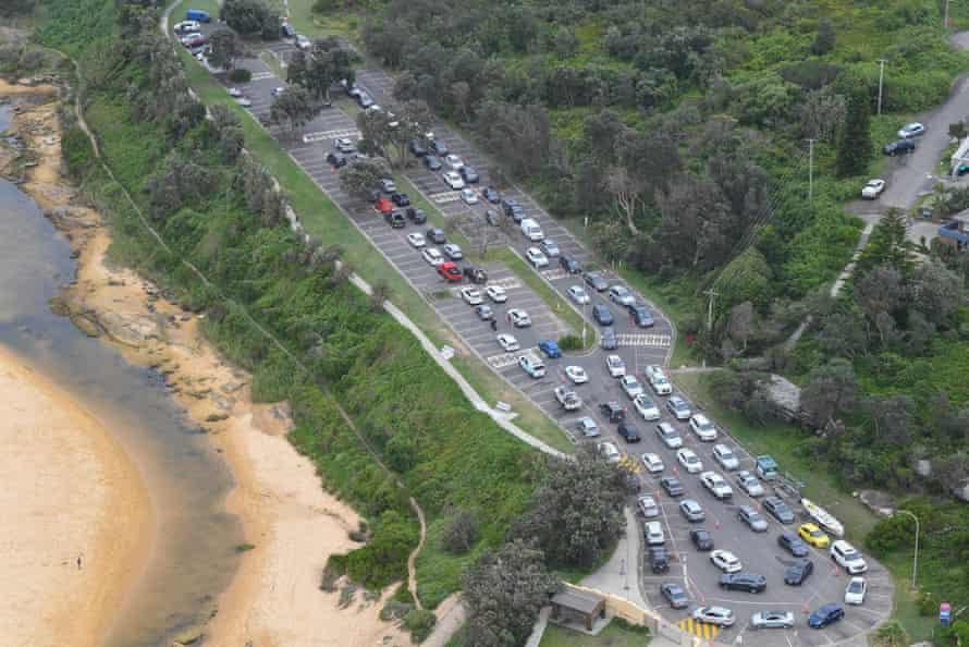 An aerial view of cars waiting in line for a Covid test at North Curl Curl surf club on Monday.