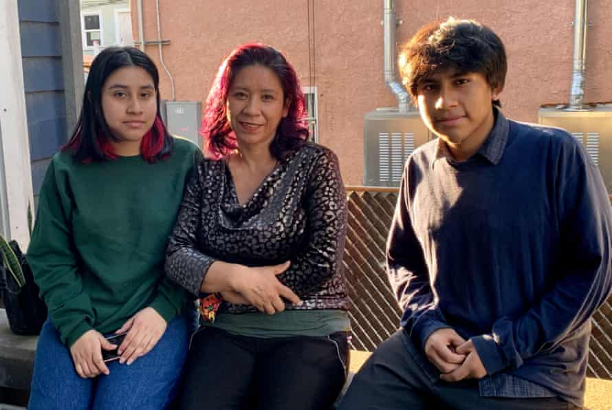 Eva Garcia, center, with her children Kimberly and Cristofer. The students, who attend Orthopaedic Hospital Medical Magnet high school in Los Angeles, have struggled to stay connected to the internet for distance learning since schools closed a year ago.