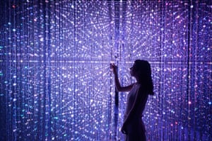 Beijing, China. A visitor touches one of the interactive digital installations at the teamLab: Dance! Art Exhibition & Learn! Future Park exhibition