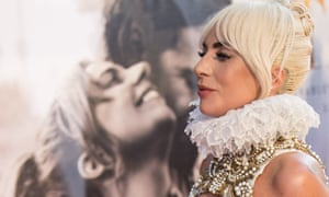 Lady Gaga in front of a poster for A Star Is Born at the film's London premiere.