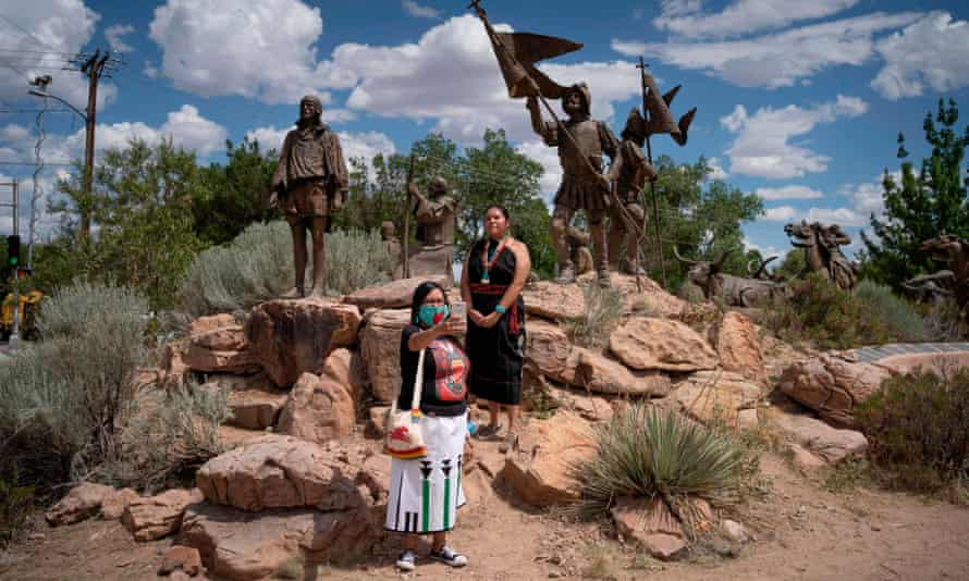 Acoma Pueblo Indians American Horse, right, and Channing Concho take a picture with the Juan De Oñate monument.