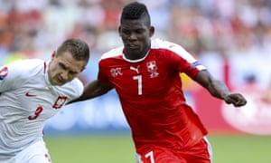 Breel Embolo, right, shrugs off Poland's Artur Jedrzejczyk during Switzerland's Euro 2016 defeat
