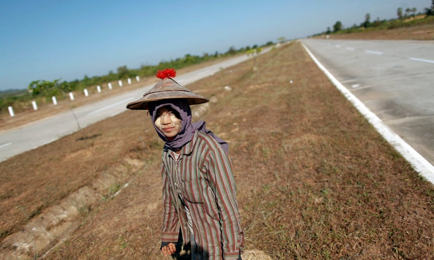 A girl walks between lanes of an empty highway connecting Myanmar's biggest city Yangon and its new capital Naypyitaw.
