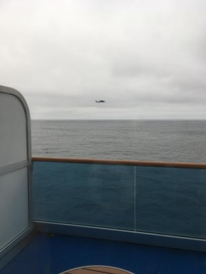 Picture taken by a Grand Princess cruise ship passenger from their cabin of military helicopters arriving to drop off coronavirus test kits.