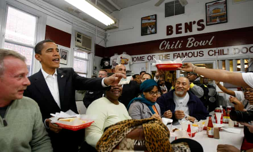 Barack Obama stops to eat in Ben's Chili Bowl in Washington before his inauguration in 2009.