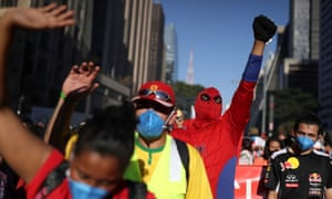 A man dressed as Spiderman shouts and raises his wrist during a protest to demand the impeachment of Brazil's president Jair Bolsonaro and against his handling of the coronavirus pandemic, on Paulista Avenue in Sao Paulo, Brazil.