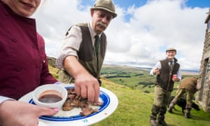 Members of a shoot eat freshly shot and cooked grouse
