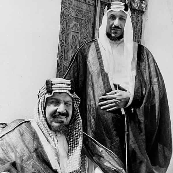 The founding monarch of Saudi Arabia, King Abdulaziz, seated, poses with his son Prince Saud.