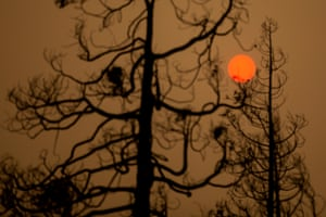 The sun shines red in the smoke of the Creek Fire near Shaver Lake, in the Sierra National Forest, California.