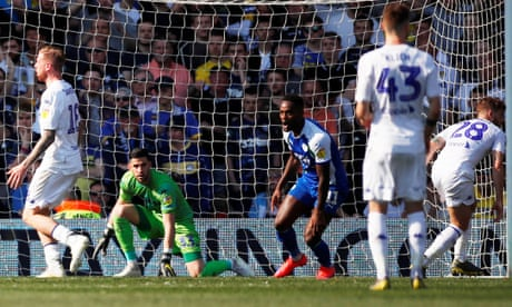 Ten-man Wigan stun Leeds to blow Championship promotion race open