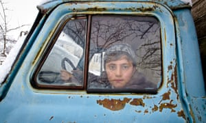Murshud in the front seat of a car