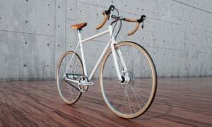 Favorit BigBoss bike on a wooden floor with concrete walls behind
