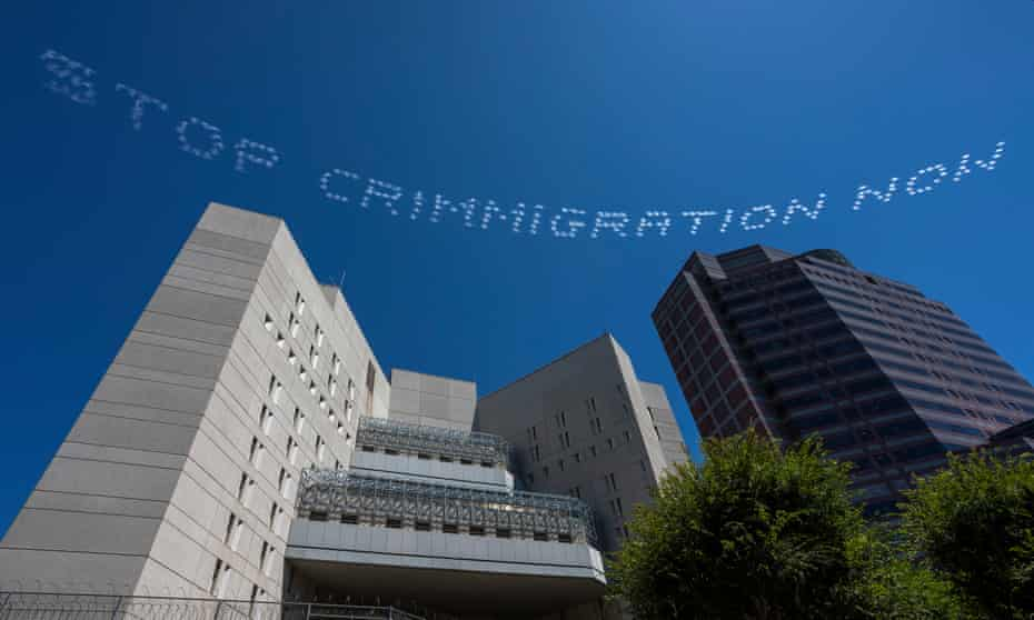 'STOP CRIMMIGRATION NOW' is seen over the Metropolitan Detention Center in Los Angeles, California.