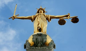 Lady Justice at the Central criminal court. The Law Society believes the poorest in England and Wales can no longer afford representation.