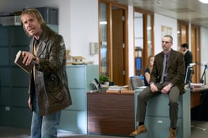 Rhys Ifans as the Observer's Ed Vulliamy, with Matthew Goode as Peter Beaumont in Official Secrets.