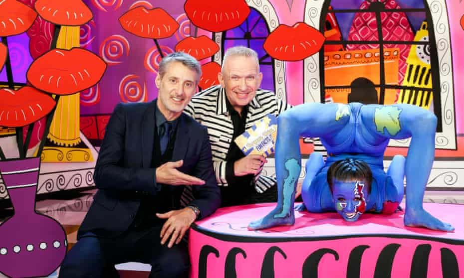 'Just to keep things interesting'… presenters Antoine de Caunes and Jean Paul Gaultier with a contortionist covered in a map of European member nations.