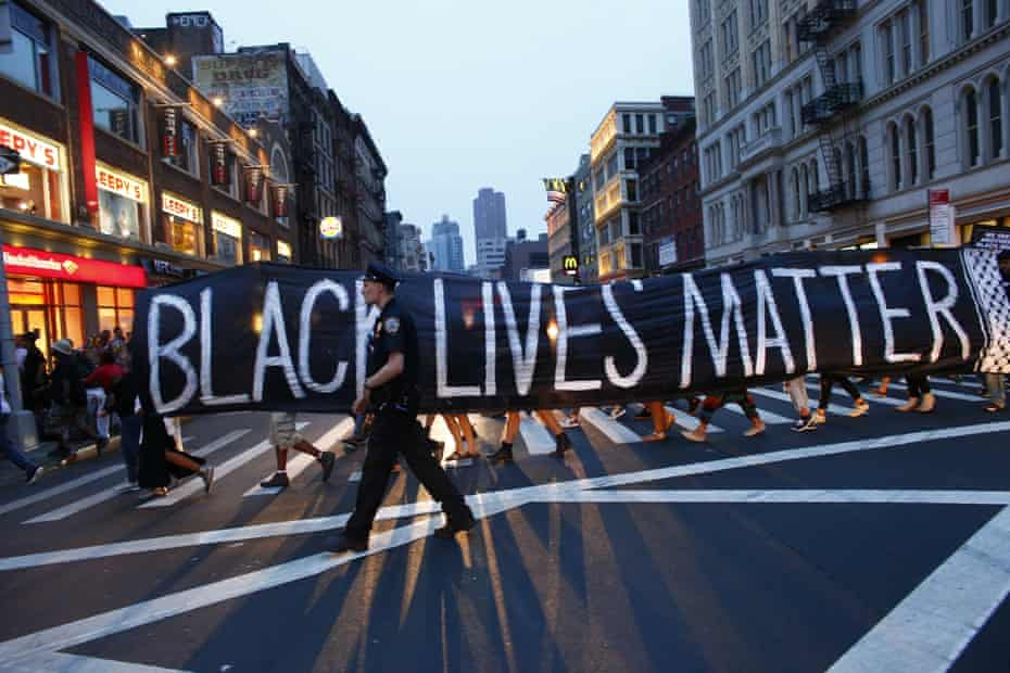 A police officer patrols during a protest in support of the Black lives matter movement in New York on July 09, 2016. The gunman behind a sniper-style attack in Dallas was an Army veteran and loner driven to exact revenge on white officers after the recent deaths of two black men at the hands of police, authorities have said. Micah Johnson, 25, had no criminal history, Dallas police said in a statement.