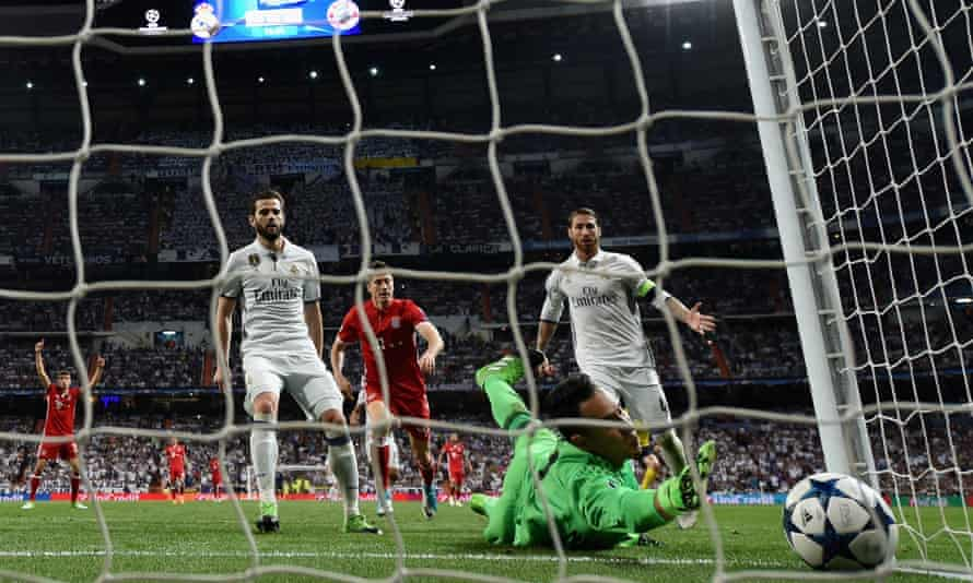 Sergio Ramos, right, can only watch as his touch dribbles past Keylor Navas.